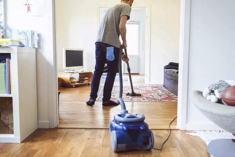 Man Vacuuming Living Room