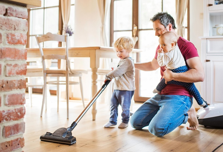 Father Vacuuming With Kids