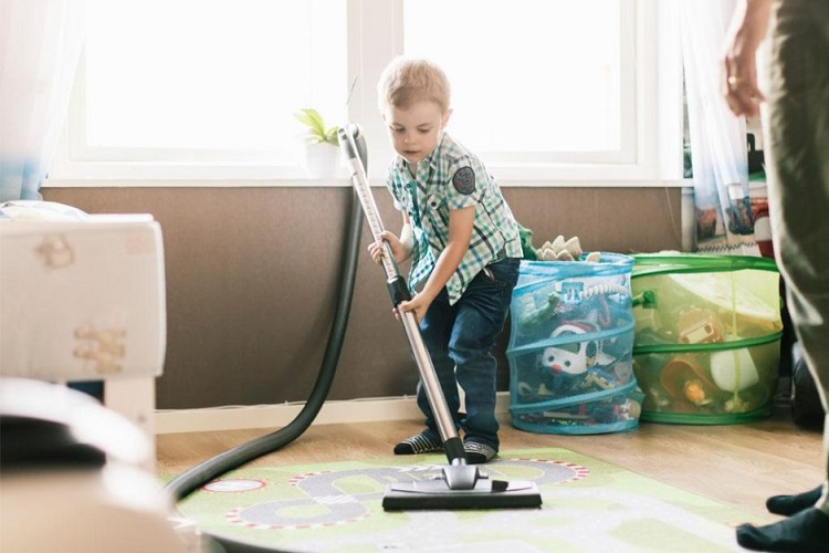 young boy learn how to clean